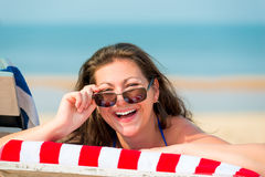 Portrait of a laughing girl on the beach Stock Photography