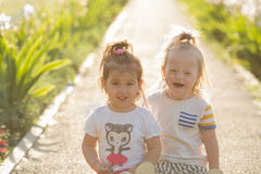 Portrait of a laughing girl with Down syndrome and girlfriends Royalty Free Stock Image