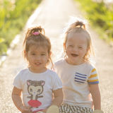 Portrait of a laughing  girl with Down syndrome and girlfriends Stock Images