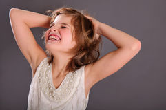 Portrait of a laughing girl with her eyes closed Stock Images