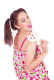 Portrait of laughing girl  holding big lollipop Royalty Free Stock Images