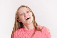 Portrait of the laughing girl on a light background Stock Photo