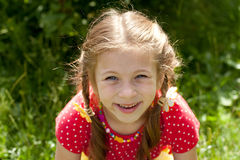 Portrait of laughing girl with pigtails Stock Images