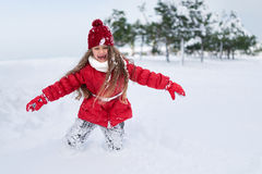 Portrait of laughing girl running in snow Royalty Free Stock Photos