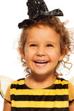 Portrait of laughing girl in striped bee costume Royalty Free Stock Image