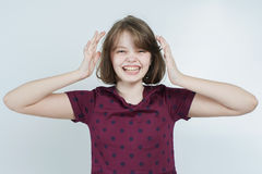 Portrait of the laughing girl who keeps his head. Stock Images