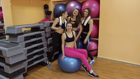 Portrait laughing girls in gym balls. stock video footage