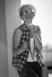 Portrait of laughing hipster girl blowing soap bubbles on street Stock Photos