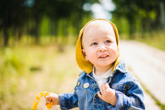 Portrait of a laughing little boy outdoors. Walk in nature with sunlight Royalty Free Stock Image