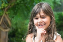 Portrait of laughing little girl with long hair Royalty Free Stock Photo