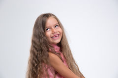 Portrait of a laughing little girl looking away. Isolated on a white background Stock Photos