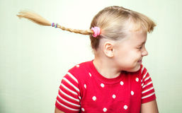 Portrait of laughing little girl with pigtails Royalty Free Stock Image