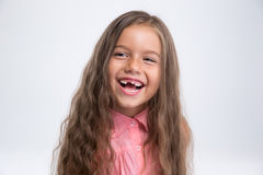 Portrait of a laughing little girl. Standing isolated on a white background Stock Images