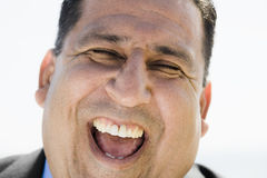 Portrait of Laughing Man. Portrait of Overweight Laughing Man With Eyes Closed Stock Images