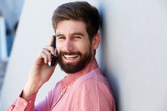 Laughing man having conversation on smart phone Stock Photo