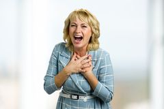 Portrait of laughing mature woman. Royalty Free Stock Image