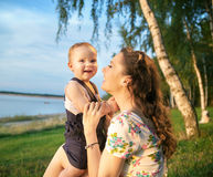 Portrait of the laughing mother and baby Royalty Free Stock Photos