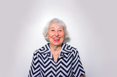 The portrait of a laughing old woman Stock Images