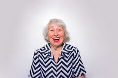The portrait of a laughing old woman Stock Image