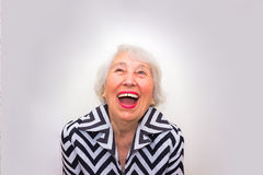 The portrait of a laughing old woman Royalty Free Stock Image