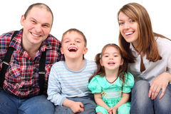 Portrait of laughing parents and children Stock Images