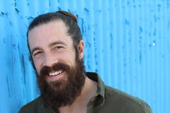 Portrait of laughing sexy man with long beard Royalty Free Stock Photography