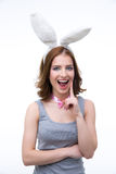 Portrait of laughing woman with bunny ears Stock Photography