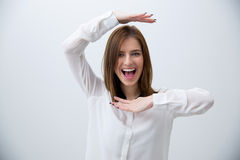 Portrait of a laughing woman gesturing frame Stock Photo