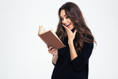 Portrait of a laughing woman reading book Stock Photos