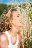 Laughing woman in summer Royalty Free Stock Photography