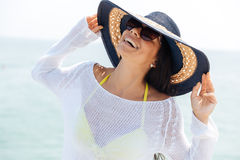 Portrait of a laughing woman wearing beach hat and bikini Royalty Free Stock Image