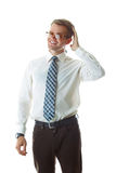 Portrait of laughing young business man touching his hair Royalty Free Stock Photos