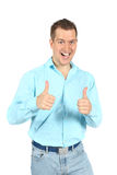 Portrait of laughing young man with thumbs up sign. Successful laughing young man with with thumbs up gesture ok. Isolated on white studio background Royalty Free Stock Photo
