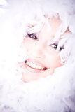 Portrait of laughing young woman with boa ov Royalty Free Stock Photos