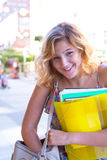 Portrait of a laughing young woman, student with colorful exerci Stock Photo