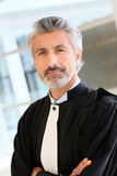 Portrait of lawyer in advocate suit. Portrait of lawyer standing in courthouse corrridor Stock Photos