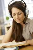 Portrait of learning woman with headphones Royalty Free Stock Photography