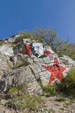 Portrait of Lenin and red star on a rock. Stock Image