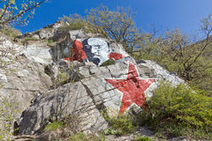 Portrait of Lenin on a rock. RUSSIA PYTIGORSK CIRCA 1925: Portrait of Lenin and red star on the western slope of Mount Mashuk. Portrait artist Shuklinov written stock image