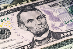 Portrait of Lincoln in front of dollar bill Stock Images