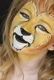 Portrait of Lion woman faceart. There is a faceart  of  lion woman. It is a animal facepainting royalty free stock images
