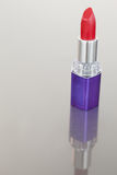 Portrait of a lipstick with a purple tube Stock Images