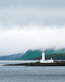 Portrait of Lismore lighthouse in Scotland. The lone white lighthouse of Lismore under a layered gray sky with copy space, near Mull and Oban, in the Inner Stock Photo