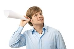 Portrait of listening young man Stock Photo