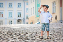 Portrait of a little 3 years old boy outdoors Stock Photos