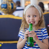 Portrait of little adorable charming girl with bottle water Stock Photos
