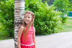 Portrait of little adorable girl with flowers in Royalty Free Stock Photography