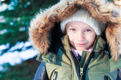 Portrait of little adorable girl in snow sunny Stock Photography