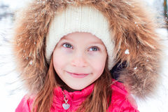 Portrait of little adorable girl in snow sunny Stock Photos