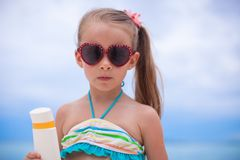 Portrait of Little adorable girl in swimsuit holds Stock Images